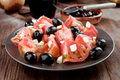 tomato salad and black olives on rustic wooden board - PhotoDune Item for Sale