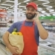 Handsome Grocery Delivery Man Talking To Mobile and Holding Grocery Paper Bag - VideoHive Item for Sale