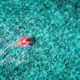 Aerial view of woman on the swim ring in the sea - PhotoDune Item for Sale