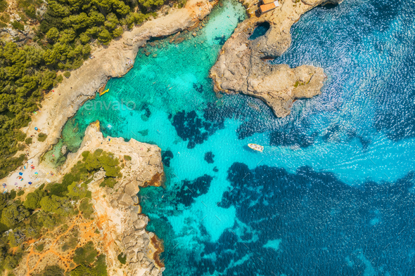 Aerial view of seashore with transparent blue water - Stock Photo - Images