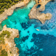Aerial view of seashore with transparent blue water - PhotoDune Item for Sale