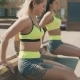 Two Fitness Women Doing Triceps Exercise Outdoors in Morning in - VideoHive Item for Sale