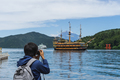 Young traveler takeing photo of  Hakone shrine with sightseeing cruise - PhotoDune Item for Sale