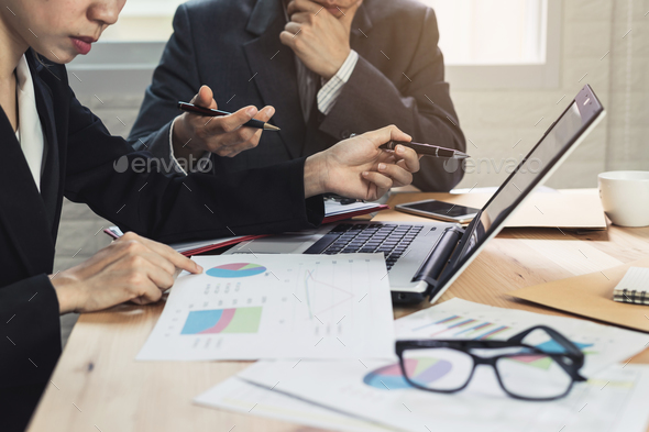 Coworkers team brainstorming and meeting to discuss and analysis - Stock Photo - Images