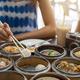 Young woman traveler eating local food(dim sum) at phuket, Thailand - PhotoDune Item for Sale