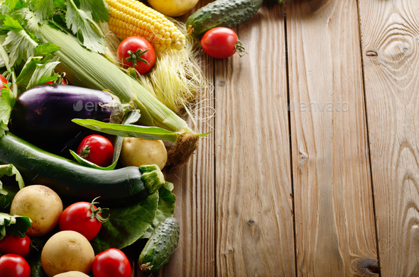 Fresh Organic Vegetable Food Ingredients on Wooden kitchen table - Stock Photo - Images