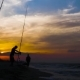 Fisherman Using Fishing Rod for Catch Fish in Sea on Beautiful Sunset in Sky - VideoHive Item for Sale