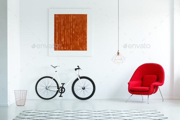 Real photo of a bike with black tires, red armchair, painting an - Stock Photo - Images