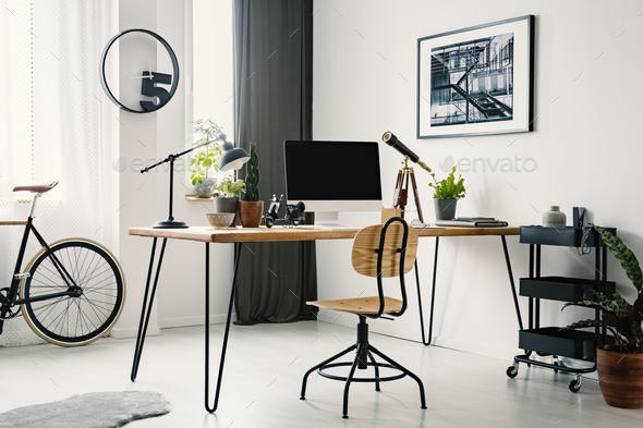 Wooden chair at desk with desktop computer in bright workspace i - Stock Photo - Images