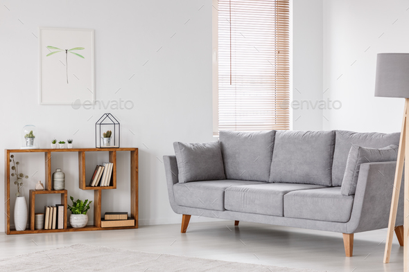 Real photo of a scandi living room interior with gray settee sta - Stock Photo - Images