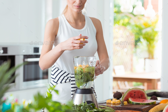 Lady preparing a smoothie - Stock Photo - Images