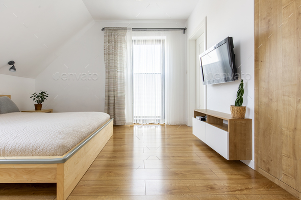Real photo of a bright and spacious hotel bedroom interior with - Stock Photo - Images