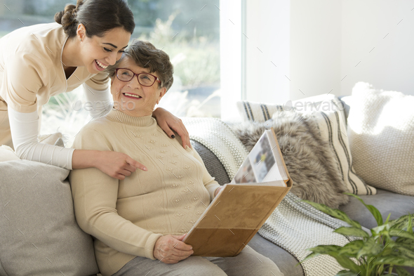 Grandmother with tender caregiver - Stock Photo - Images
