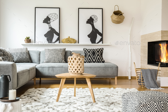 Wooden table on carpet in african living room interior with patt - Stock Photo - Images