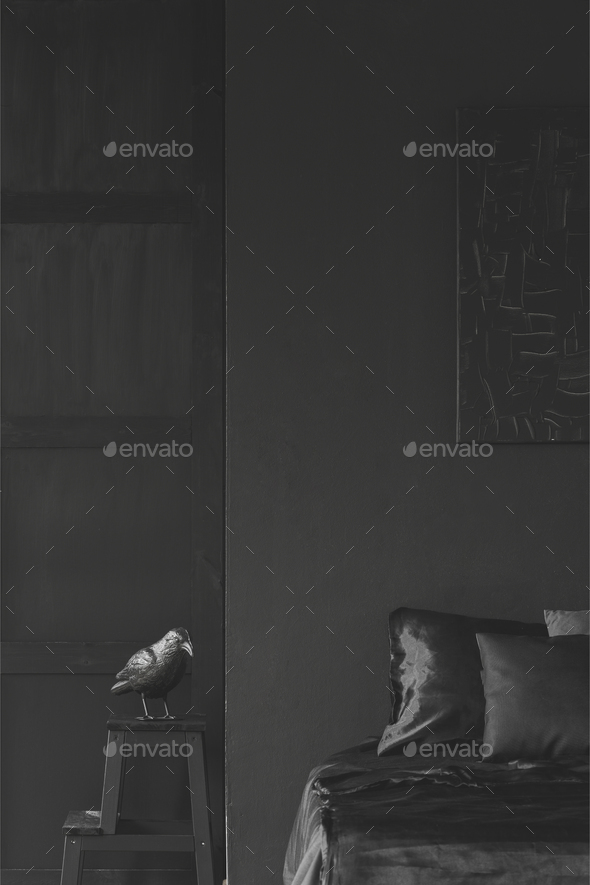 Sculpture on stool next to bed in black bedroom interior with de - Stock Photo - Images