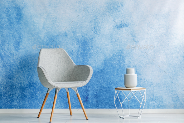 Copy space room interior with simple gray armchair and openwork - Stock Photo - Images