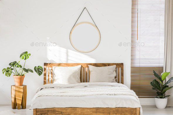 Sun shining on a white wall with a round mirror in a minimalist - Stock Photo - Images