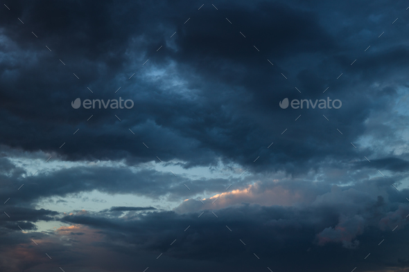 Dramatic sunset sky with orange colored clouds. - Stock Photo - Images