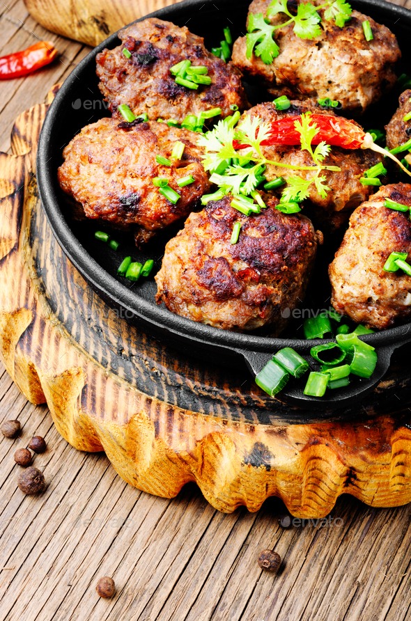 Meatballs in cast iron skillet - Stock Photo - Images