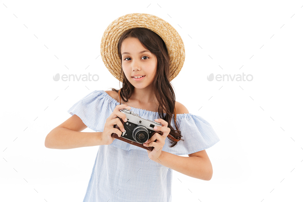 Girl tourist photographer isolated over white wall - Stock Photo - Images