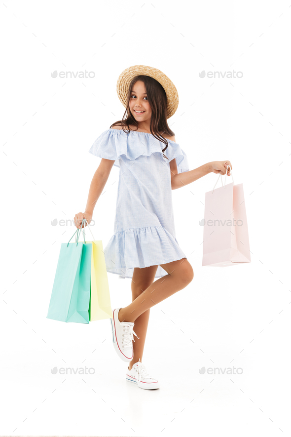 Full length image of Smiling young brunette girl in dress - Stock Photo - Images