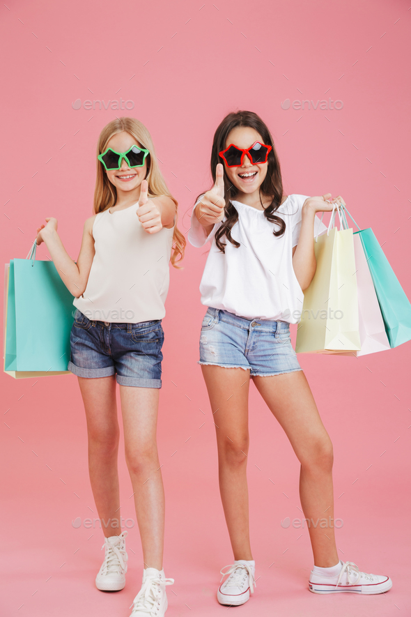 Full length image of stylish brunette and blonde girls 8-10 wear - Stock Photo - Images