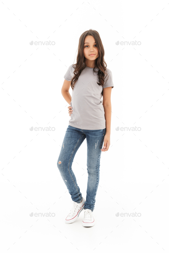 Girl standing posing isolated over white wall background. - Stock Photo - Images