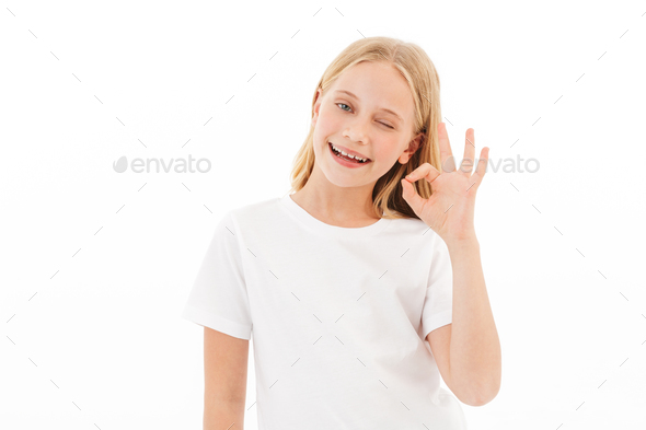 Pretty cute girl showing okay gesture. - Stock Photo - Images