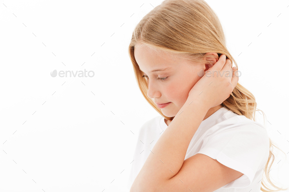 Side view of Shy young blonde girl in casual clothes - Stock Photo - Images