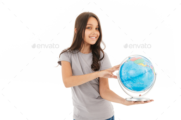 Cute girl standing isolated holding globe. - Stock Photo - Images