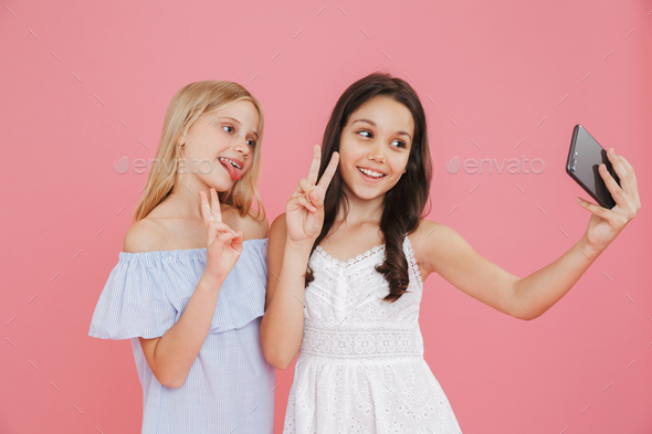 Picture of brunette and blonde adorable girls wearing dresses sm - Stock Photo - Images