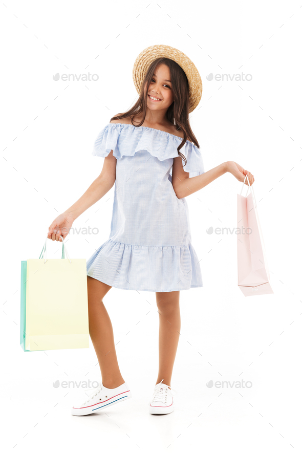 Full length image of Happy young brunette girl in dress - Stock Photo - Images