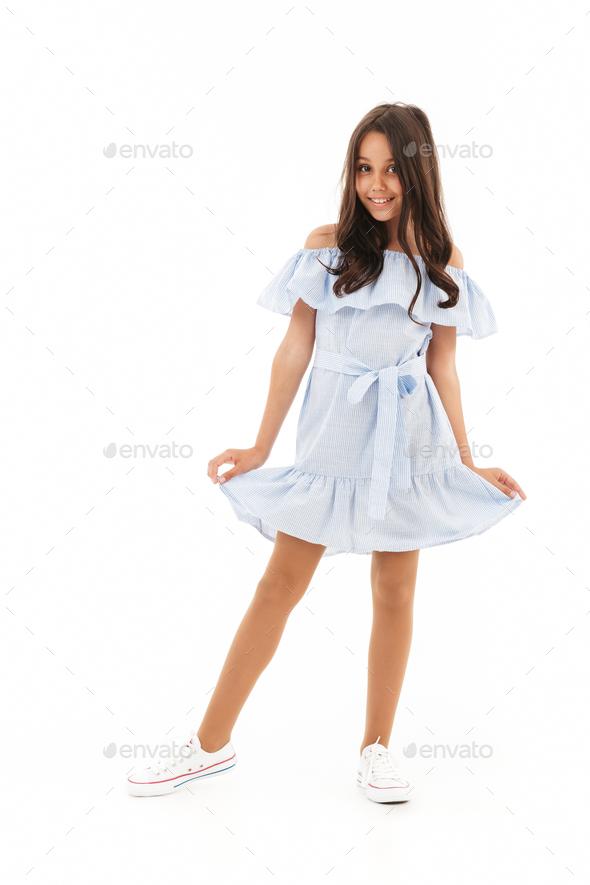 Full length image of Pleased brunette girl in dress posing - Stock Photo - Images