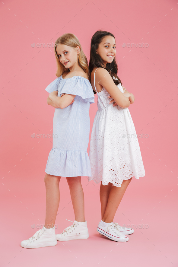 Full length photo of brunette and blonde girls wearing dresses s - Stock Photo - Images