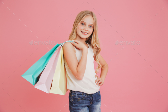 Blond caucasian girl 8-10 in casual clothing smiling at camera a - Stock Photo - Images