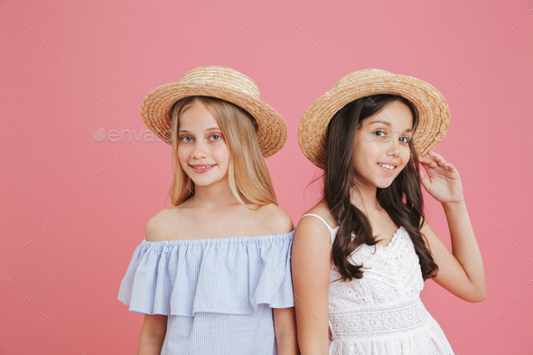 Picture of brunette and blonde summer girls wearing dresses and - Stock Photo - Images