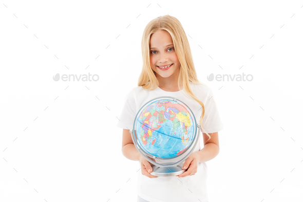 Smiling young blonde girl in casual clothes holding globe - Stock Photo - Images