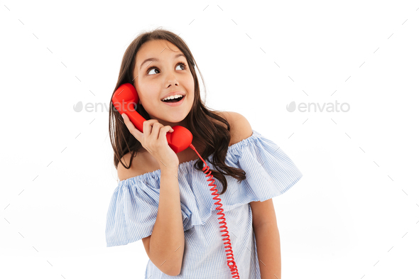 Prretty cute girl talking by telephone. - Stock Photo - Images