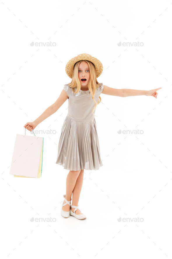 Full length image of Surprised young blonde girl in dress - Stock Photo - Images