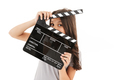 Cute girl holding film making clapperboard. - PhotoDune Item for Sale