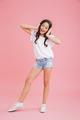 Full length portrait of cheerful girl 8-10 in casual clothing si - PhotoDune Item for Sale