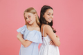 Picture of brunette and blonde adorable girls wearing dresses sm - PhotoDune Item for Sale