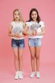 Full length image of delighted brunette and blonde girls 8-10 we - PhotoDune Item for Sale