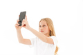 Pretty blonde girl in casual clothes making selfie on smartphone - PhotoDune Item for Sale