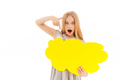 Shocked young blonde girl in dress holding blank speech cloud - PhotoDune Item for Sale