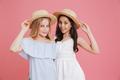 Portrait of brunette and blonde summer girls 8-10 wearing dresse - PhotoDune Item for Sale