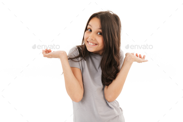 Cute funny girl standing isolated - Stock Photo - Images