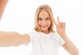 Cheerful young blonde girl in casual clothes making selfie - PhotoDune Item for Sale