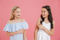 Picture of happy brunette and blonde girls 8-10 years old wearin - PhotoDune Item for Sale