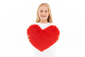 Happy young blonde girl in casual clothes giving joy heart - PhotoDune Item for Sale